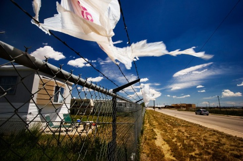 Plastic bags flutter in the wind outside a trailer park in Rawlins, Wyo. These parks sit wedged between historical downtown and new neighborhoods being built. (Photo/Morgan E. Heim)